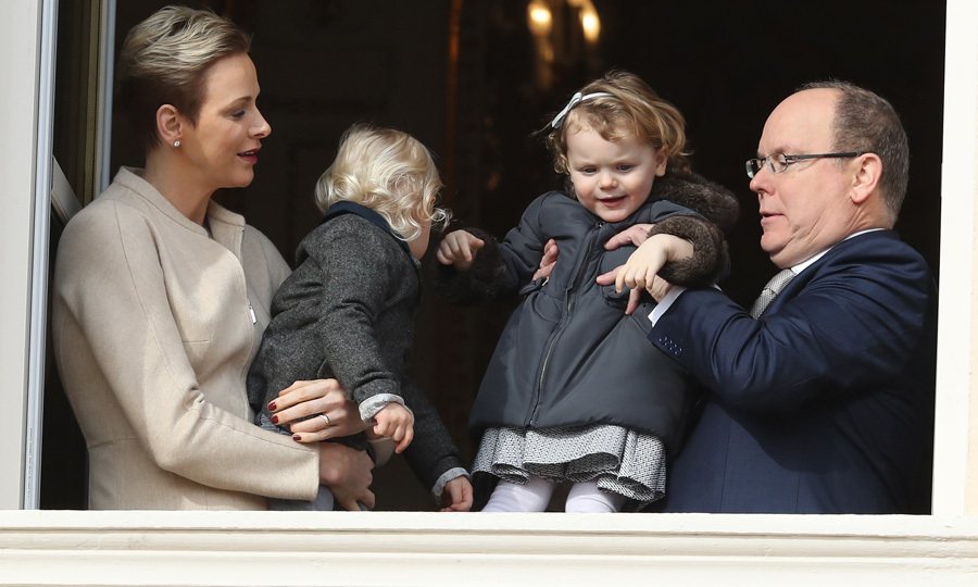Albert gave his daughter Princess Gabriella a lift to better see on the balcony of the palace.