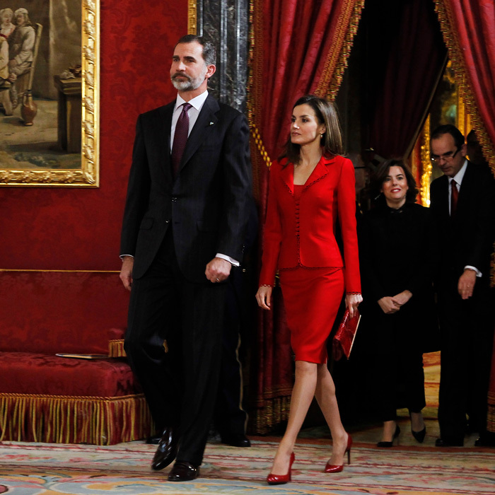 Queen Letizia wowed in a red ensemble on her husband King Felipe VI's 49th birthday as they attended an official engagement at the Royal Palace in Madrid.