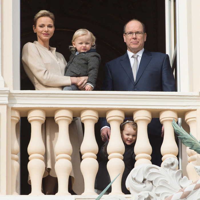 Princess Gabriella of Monaco peered through the balcony railing as she gathered with her twin brother Prince Jacques and their parents, Princess Charlene and Prince Albert, for Sainte-Devote festivities at the Palace.