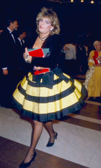 The Monaco Princess was rocking the Farrah Fawcett hairdo in the '80s stepping out to the 1987 Rose Ball wearing a yellow and black ensemble.