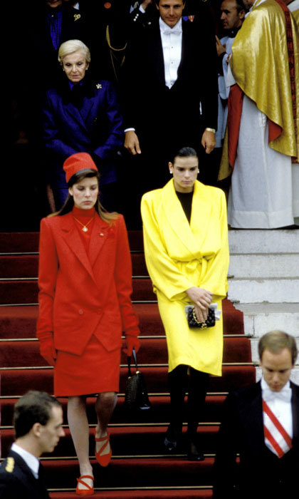 Stephanie looked sunny wearing a vibrant yellow wrap coat to the cathedral of Monaco during National Day with her family.