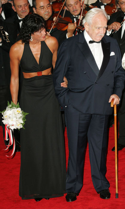 The Princess flashed her enviable abs in a daring black cut-out dress as she arrived to the 2004 Monaco Red Cross Ball with her father Prince Rainier.