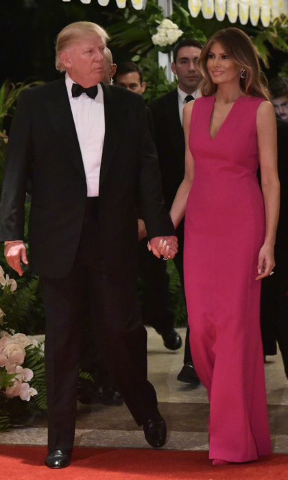 The first lady donned a full-length, vibrant gown by Christian Dior, which she accessorized with emerald and diamond jewels for the 60th annual Red Cross Gala at the Trump's Mar-a-Lago estate in Palm Beach. 