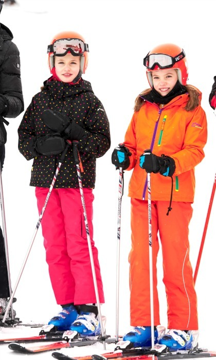 Letizia and Felipe's girls added some style to the slopes during a private family ski break in February 2017. The duo wore matching orange helmets but added their individual pop of color to their sporty attire. 