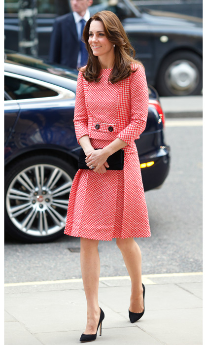 The royal looked retro chic sporting a red and white skirt suit by Eponine London for her visit to the XLP project London Wall mentoring program in 2016.