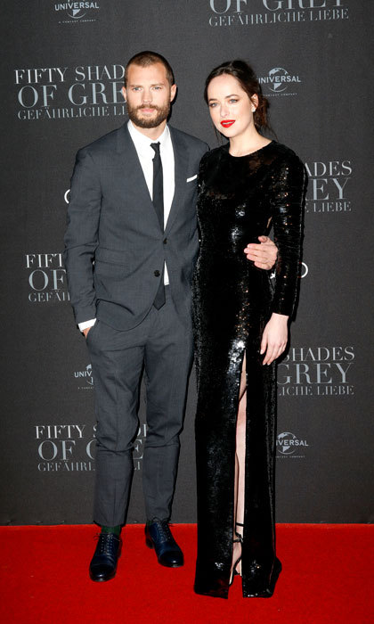 February 7: Jamie Dornan and Dakota Johnson looked fifty shades <i>dark</i>-er  at the European premiere of their new film <i>Fifty Shades Darker</i> in Hamburg, Germany. The actress dazzled wearing a long-sleeve Saint Laurent gown, alongside her co-star, who sported a grey suit.