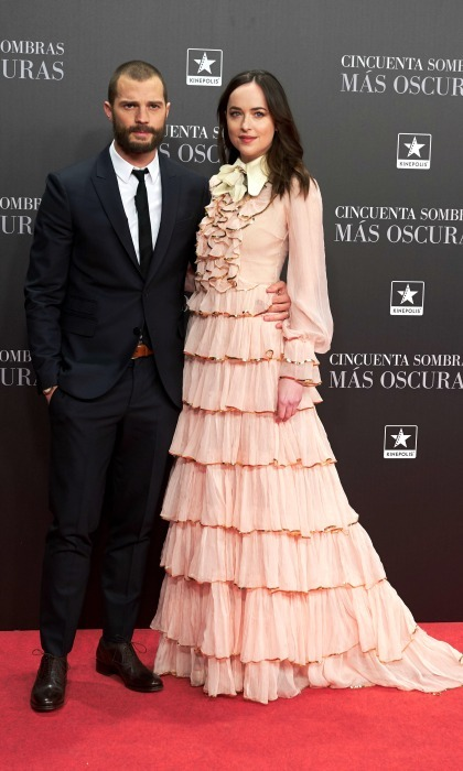 February 8: Dakota Johnson was layered in Gucci as she stood next to Jamie Dornan during the <i>Fifty Shades Darker</i> premiere in Madrid. 