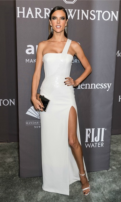 February 8: Versace, Versace, Versace! Alessandra Ambrosio showed some major leg in a white dress by Versace during the Fiji Water sponsored amfAR New York Gala.