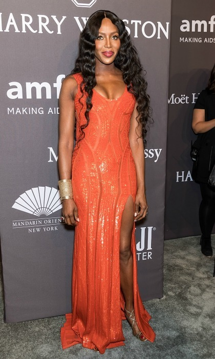 February 8: Naomi Campbell shined in an orange dress by Versace during the 19th Annual amfAR New York Gala. 