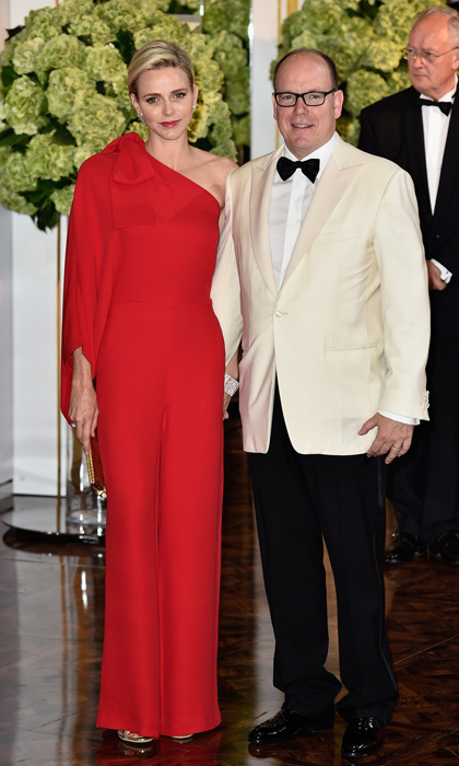Mom-of-two, Princess Charlene, stunned stepping out to the 2015 Monaco Red Cross Gala sporting a one-shoulder jumpsuit that featured a dramatic bow on the shoulder.