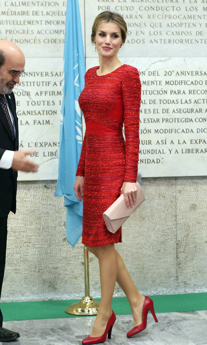 Queen Letizia sizzled in a bouclé wool sheath dress by Felipe Varela during a 2014 outing to the FAO headquarters for the second international conference on nutrition in Rome, Italy. 