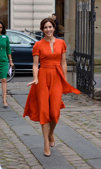 Crown Princess Mary of Denmark looked effortlessly chic wearing a Marc Jacobs wrap dress to the 2012 St. Petersburg Loye Prize and Medals ceremony in Copenhagen, Denmark. 