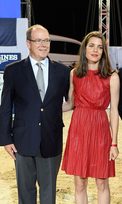 Charlotte Casiraghi was a vision in red wearing a a pleated leather dress alongside her uncle Prince Albert at the 2016  Longines Global Champions Tour of Monaco.