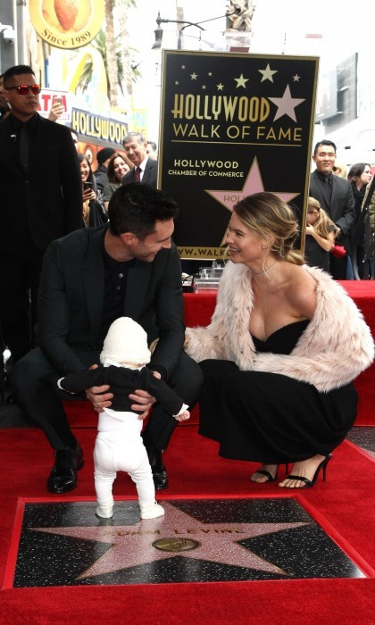 Adam Levine was supported by his two favorite girls as he received his star on the Hollywood Walk of Fame. His wife, Behati Prinsloo, and daughter, Dusty Rose Levine, attended the ceremony, eliciting cheers from the crowd. It was not only a landmark day for Adam, but was his four-month-old baby girl's public debut.