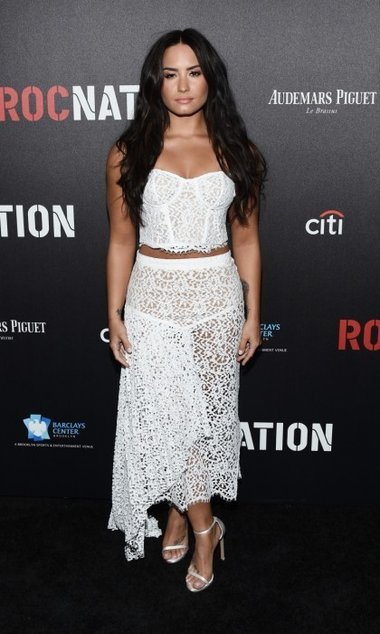 February 11: 'Confident'! Demi Lovato showed glimpses of skin in a springy white ensemble at Roc Nation's Pre-GRAMMY Brunch in L.A.
