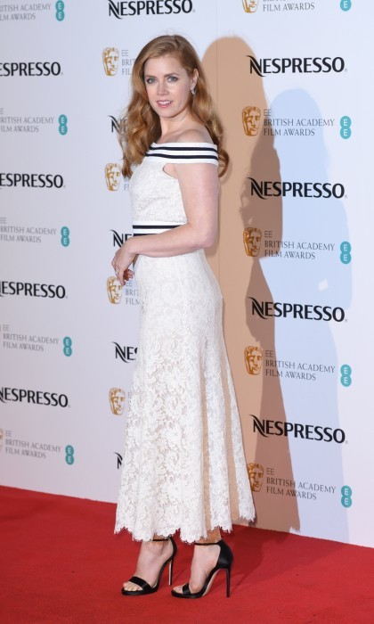 February 11: Amy Adams looked chic in a form-fitting white gown at the BAFTA nominees party at Kensington Palace in London. The acclaimed actress complimented her outfit with a stunning pair of earrings from the NIRAV MODI Jasmine collection.