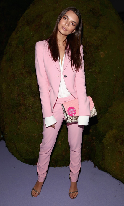 Emily Ratajkowski looked pretty in pink stepping out in a suit and coordinating clutch to the FIJI Water X Altuzarra fashion show.