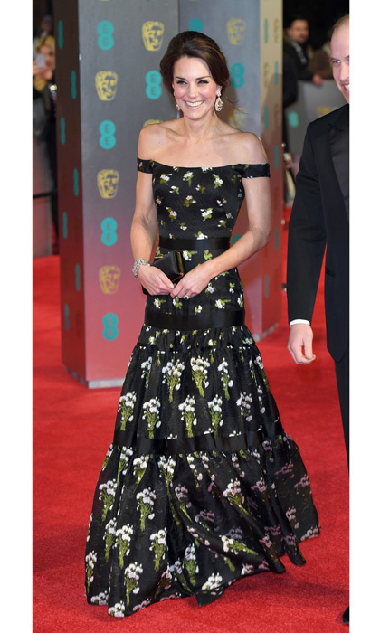 The Duchess of Cambridge exuded Hollywood glamour stepping out to the 70th EE British Academy Film Awards in London wearing a floral printed, off-the-shoulder gown by Alexander McQueen, which featured a tiered skirt.