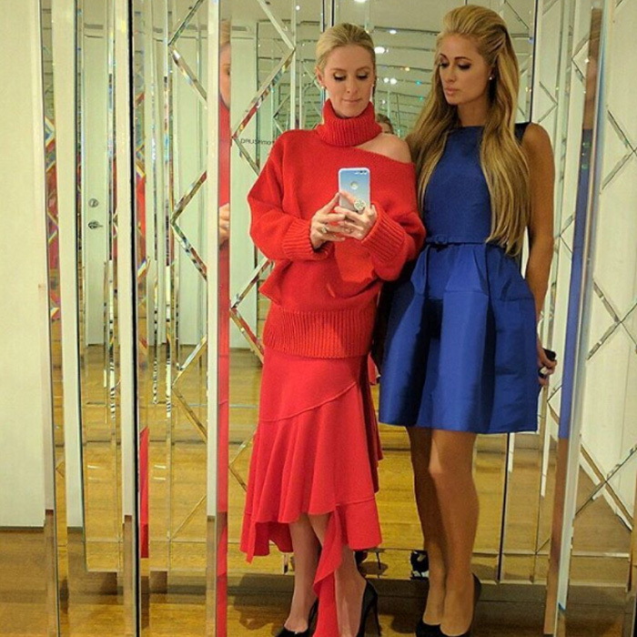 Stylish sisters! Nicky and Paris Hilton snapped a mirror selfie before heading out to the Monse and Oscar de la Renta fashion week show.