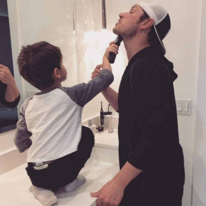 Vanessa Lachey shared a picture of her son Camden helping his dad Nick get ready for the special day.