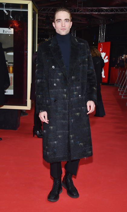 February 14: Robert Pattinson kept warm, while making a statement in an over-sized coat at the <i>Lost City of Z</i> premiere during the 67th Berlinale International Film Festival in Berlin.