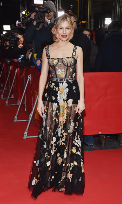 February 14: Sienna Miller brought flower power to <I>The Lost City of Z</i> in Berlin, Germany wearing a floral printed frock by Dior.