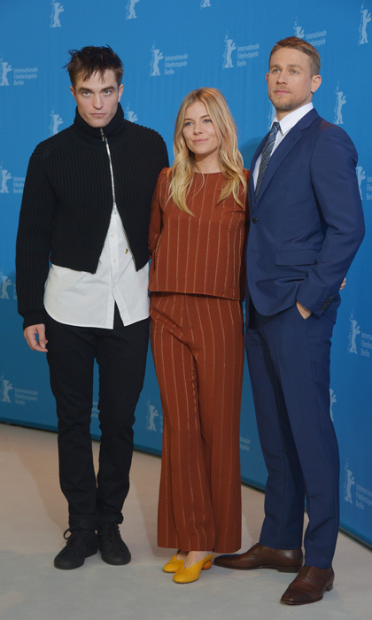 February 14: Sienna Miller found herself stylishly sandwiched between a Dior-wearing Robert Pattinson and Prada-clad Charlie Hunnam at <i>'The Lost City of Z</i> photo call during the 67th Berlinale International Film Festival Berlin.