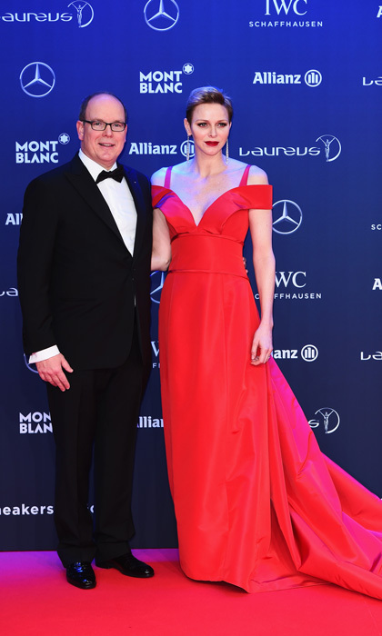 February 2017: The Princess stunned on Valentine's Day spirit wearing a plunging red, off the shoulder dress by Carolina Hererra, which she paired with a bold red lip, dazzling drop earrings and silver Jimmy Choo pumps to the 2017 Laureus World Sports Awards in Monaco.