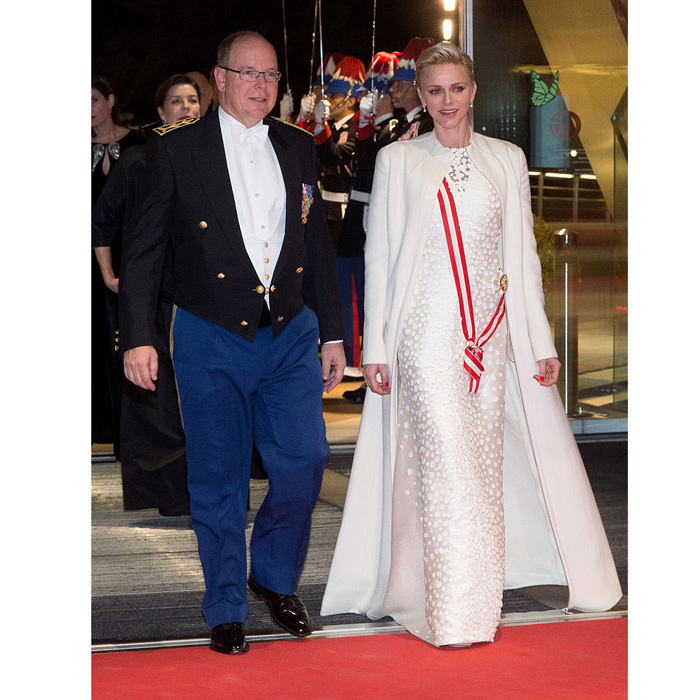 November 2016: Prince Albert's wife looked regal arriving to the Monaco National Day Gala wearing a white embellished gown by one of her favorite designers, Akris. Charlene paired the stunning dress with a matching floor-length coat.