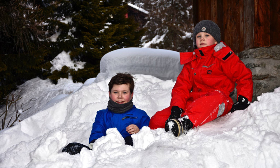 Boys will be boys. Princes Christian and Vincent played in the snow, while on vacation with their parents and sisters.