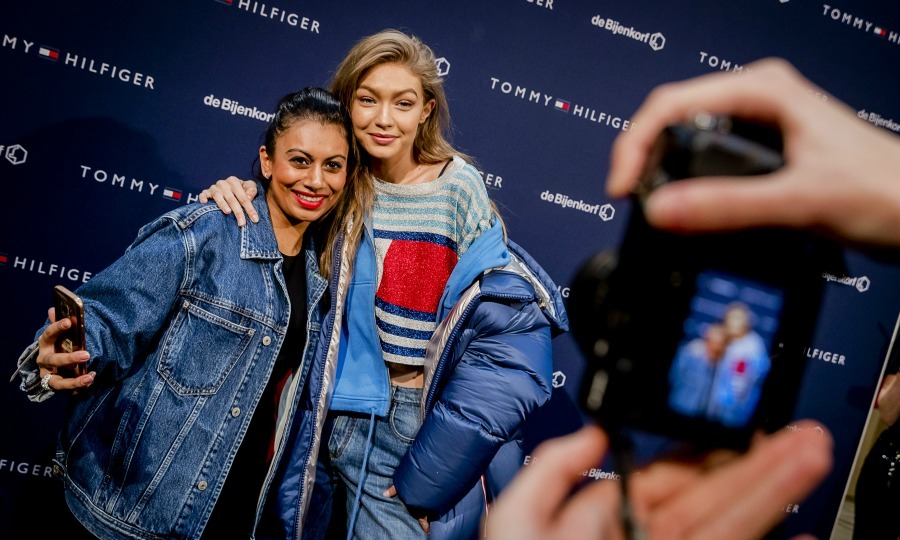 "February 17: Fresh off New York Fashion Week, Tommy Girl <a href=""http://us.hellomagazine.com/tags/1/gigi-hadid/""><strong>Gigi Hadid</strong></a> posed with a fan during a visit to the De Bijenkorf Warehouse in Amsterdam. 