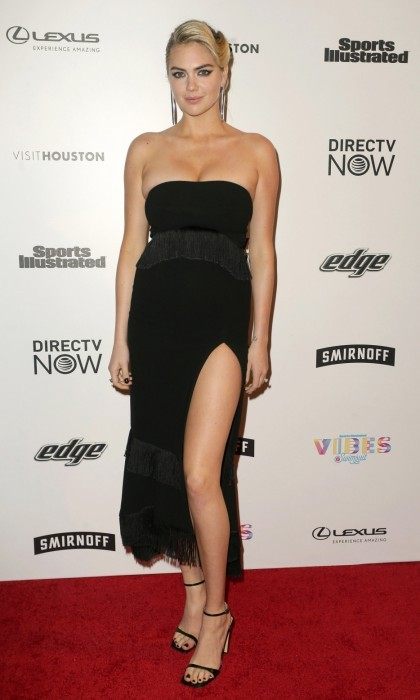 February 17: Kate Upton also hit the VIBES festival carpet in Houston, Texas. The model got leggy in a chic black dress.