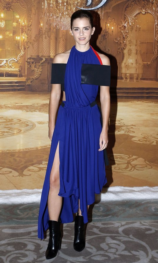 February 20: Emma Watson brought a modern feel to a Paris photocall for her new film 'Beauty and the Beast' with an electric blue halter dress by Louis Vuitton.