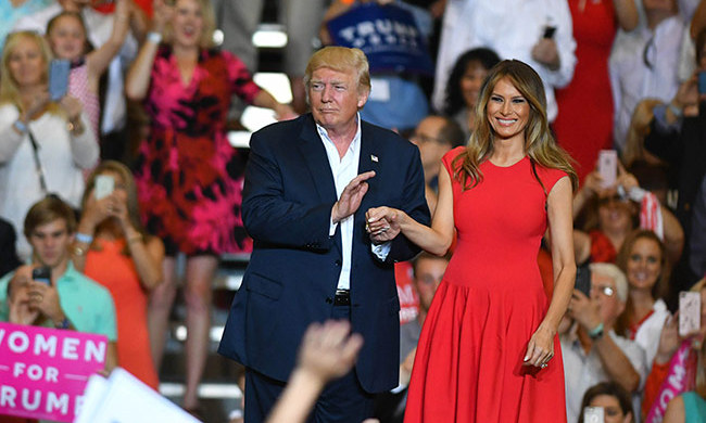 Melania showed off a lighter shade of hair as she addressed the crowd at her husband's rally in Melbourne, Florida on Saturday, February 18. The first lady looked stunning in a red cap-sleeve Alexander McQueen dress and new lighter shade of blonde hair, while speaking briefly to the gathering and then reciting the Lord's Prayer.