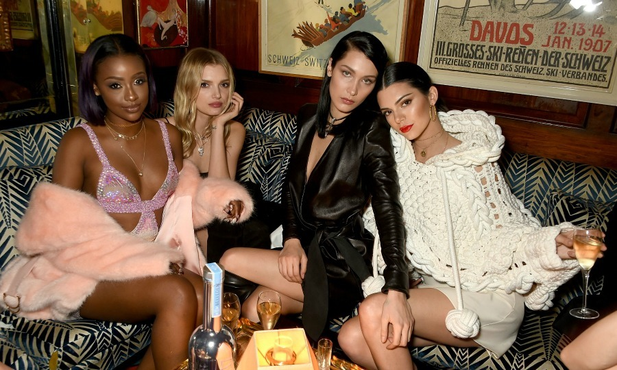 Party time! Justine Skye, Lily Donaldson, Bella Hadid and Kendall Jenner were fierce during the LOVE and Burberry party at Annabel's in London where guests sipped on Belvedere cocktails.