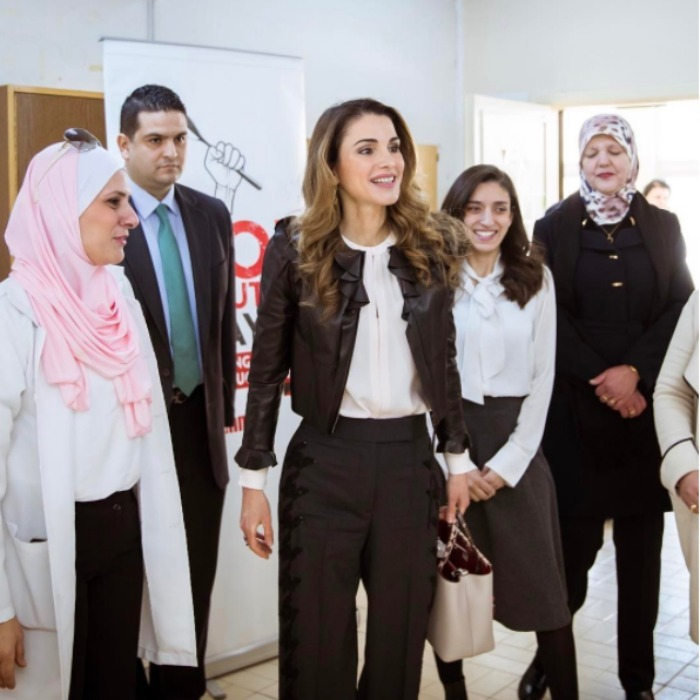 Queen Rania rocked a black leather jacket and black trousers as she showed of her edgier side during a visit to schools in Jordan. 