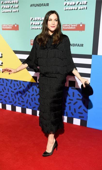 February 21: Liv Tyler shook things up in her ruffled dress by Stella McCartney during the Naked Heart Foundation's Fabulous Fund Fair in London. 