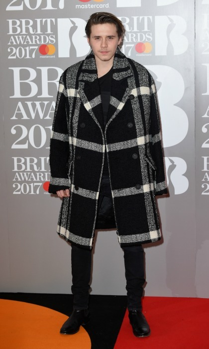 February 22: Brooklyn Beckham was on trend in an over-sized coat during the 2017 BRIT Awards in London. 