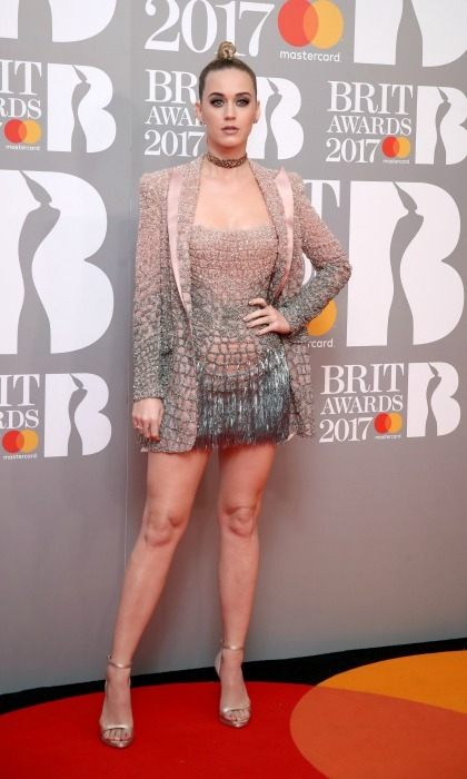 February 22: Katy Perry was chained to the fashion in a metallic dress and blazer combo at the 2017 BRIT Awards in London. 