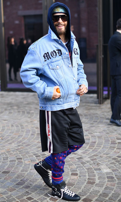 Jared Leto made a statement wearing basketball shorts, a hoodie and denim shirt to the Gucci fashion show.
