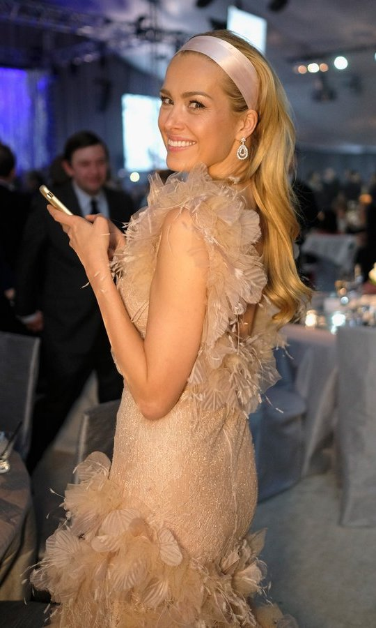 Model Petra Nemcova had her cellphone in hand to capture the best moments at the 25th Annual Elton John AIDS Foundation's Academy Awards Viewing Party. 
