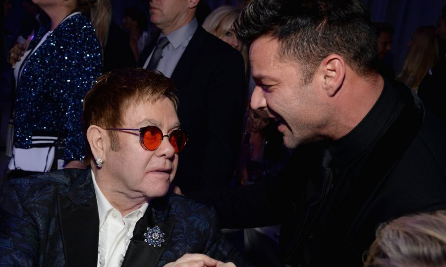 Host Elton John greeted singer Ricky Martin at the 25th Annual Elton John AIDS Foundation's Academy Awards Viewing Party. 