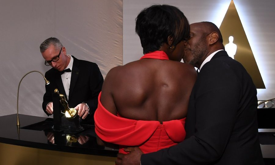 Best supporting actress winner Viola Davis got a smooch from her husband Julius as she had her trophy engraved at the 89th Annual Academy Awards Governors Ball.