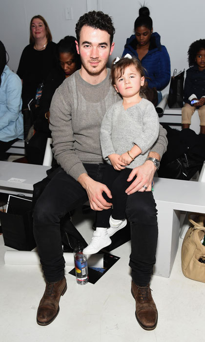 Kevin Jonas sat front row with his little girl Alena at the Rookie USA fashion show during New York Fashion Week.