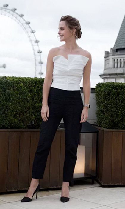 <b>London</b>: Emma kept it effortlessly chic donning a  white strapless bustier and black trousers by Spanish designer Carmen March, which she paired with her organic silk Burberry pumps for a day of press in London.