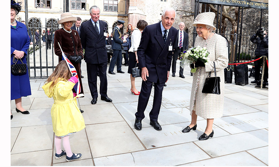 Queen Elizabeth seemed very much amused when a flag-bearing wellwisher got a little shy during Her Majesty's visit to Charterhouse Square in London. 