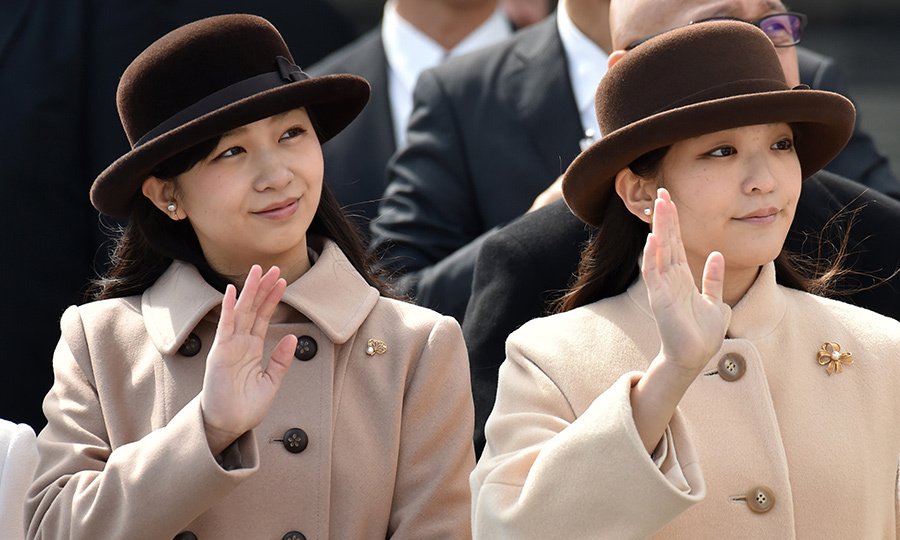 At Tokyo's Haneda airport, Japan's Princess Mako, right, and Princess Kako, left, bid farewell to Emperor Akihito and Empress Michiko as the royal couple embarked on a journey to Vietnam. 