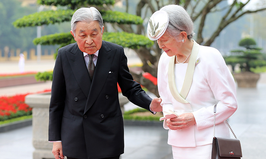 Emperor Akihito, 83, gently guided wife Empress Michiko, 82, as they attended a wreath laying ceremony at the mausoleum of Ho Chi Minh in Hanoi.