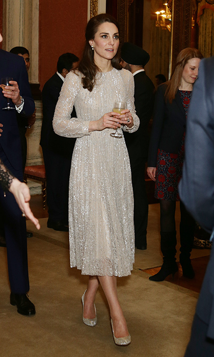 The Duchess of Cambridge turned heads in a gold Erdem dress at a reception to mark the launch of the UK-India Year of Culture 2017 at Buckingham Palace.