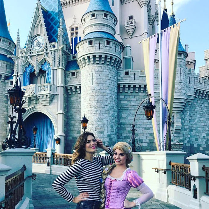 Mandy Moore and Rapunzel gave us major hair envy during the <i>Tangled Before Ever After</i> star's visit to Disney World.